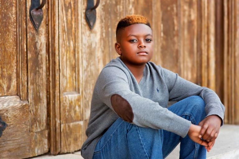 Atlanta tween photographer, boy sitting by wood doors