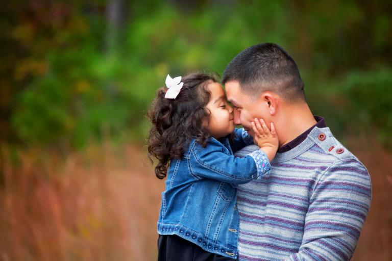 Carrollton family photographer, baby girl kissing dad's nose
