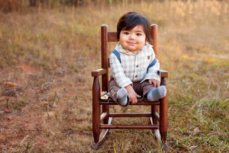 Douglasville baby photographer, boy in a rocking chair outside