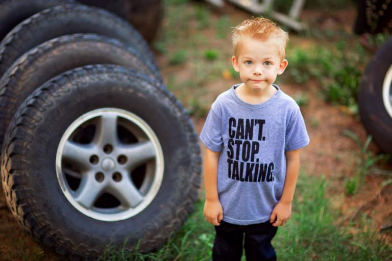 lifestyle photographer Villa Rica, child wearing Can't Stop Talking shirt