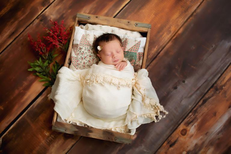 newborn photographer Villa Rica, baby girl in a wood crate