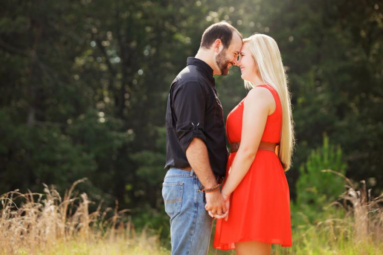 Villa Rica engagement photographer, couple in field with tall grass