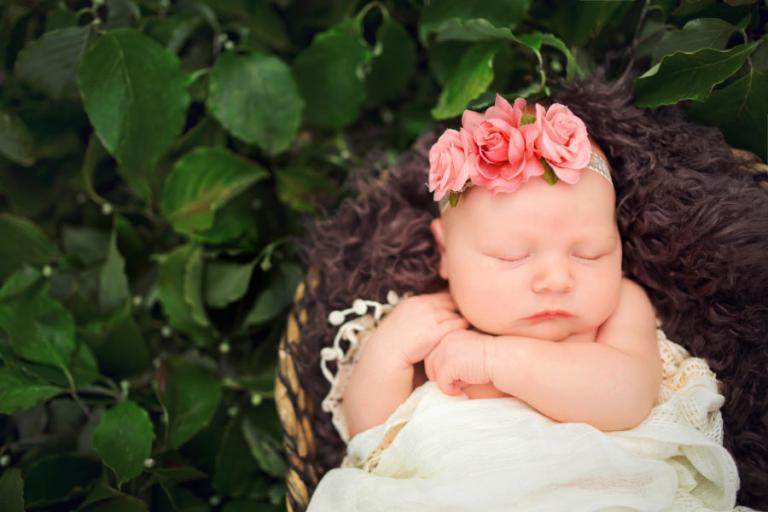 West Georgia newborn photographer, baby girl outside with leaves