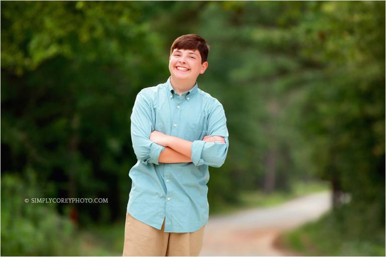 Atlanta teen photographer, boy smiling outside in country