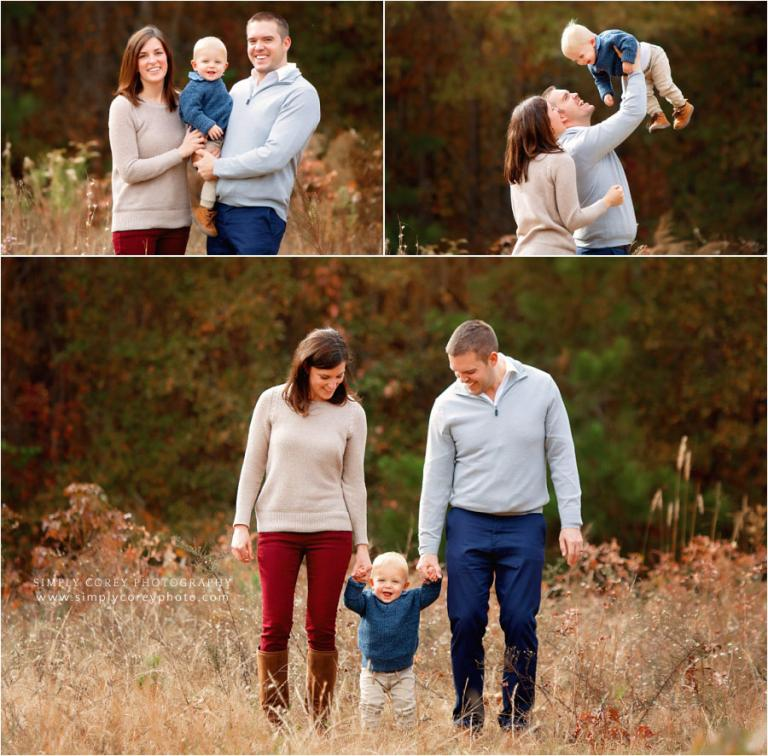 Carrollton family photographer, parents playing with baby in field
