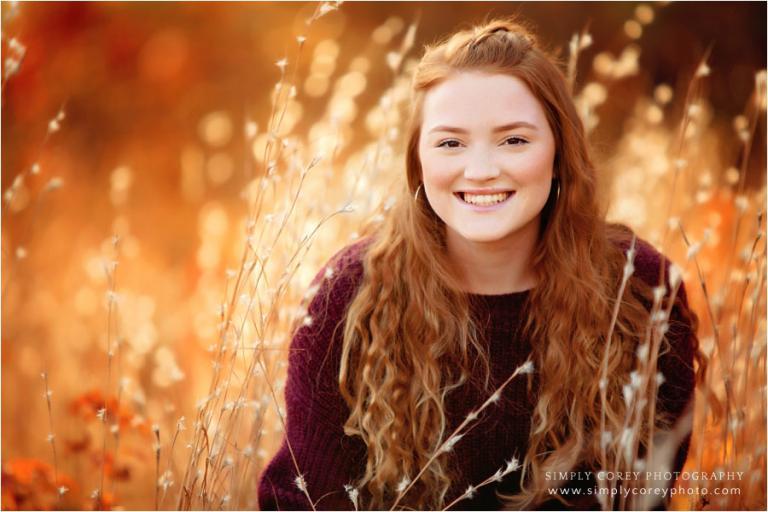 Atlanta senior portrait photographer, teen in golden fall field