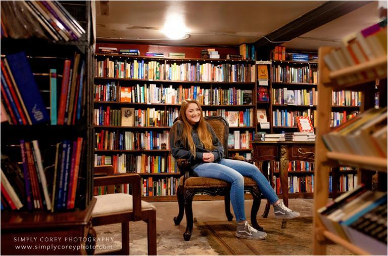 Carrollton senior portrait photographer, teen sitting in underground bookstore
