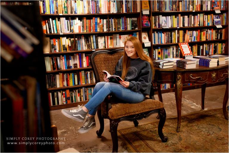 Douglasville senior portrait photographer, teen reading in Carrollton bookstore