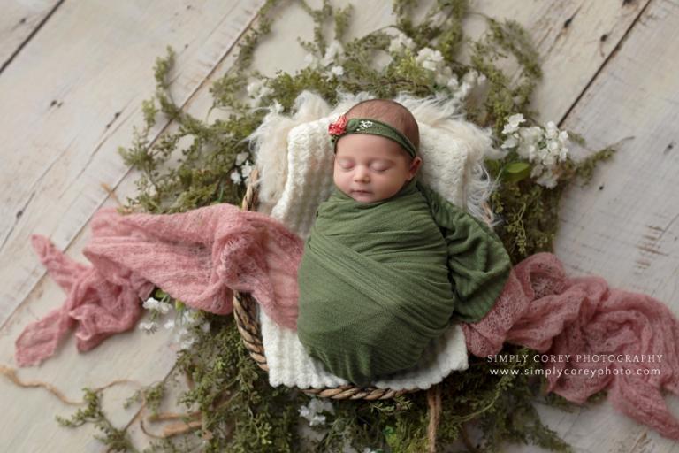 Douglasville newborn photographer, baby in studio with pink, green, and flowers