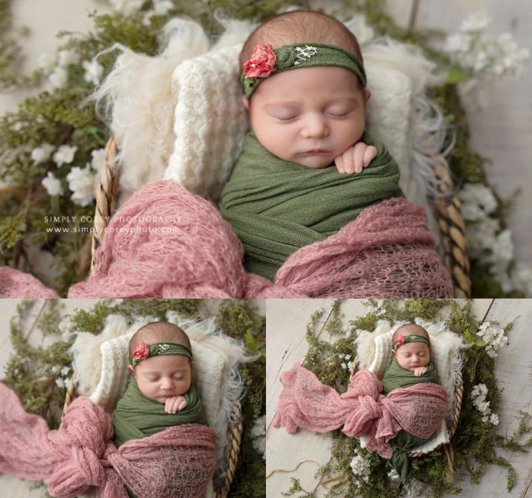Villa Rica newborn photographer, baby girl in a basket with green and pink