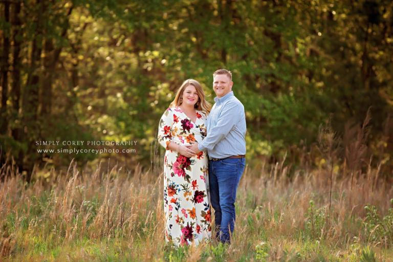 Carrollton maternity photographer, couple outside in field with tall grass