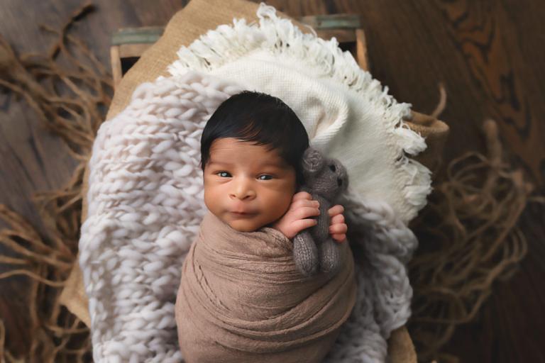 Atlanta newborn photographer, baby boy holding teddy bear