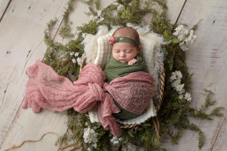 Newnan newborn photographer, baby girl in pink and green
