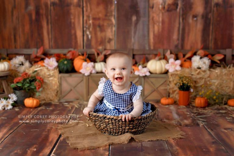 baby photographer near Atlanta, girl in basket for fall studio milestone session